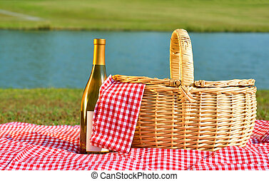 Picnic Basket and Wine - Picnic basket and bottle of white...