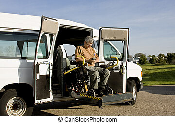 disabled wheelchair lift - handicapped man operating a...