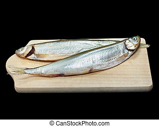Smoked fish - Smoked smelt isolated on black background