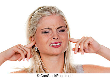 Woman suffers from noise - Young woman suffering from noise...