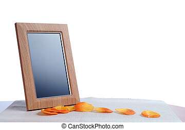 photoframe - petal and photoframe on the table in white...