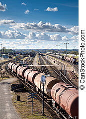 Complex railway track system and many tank cars.