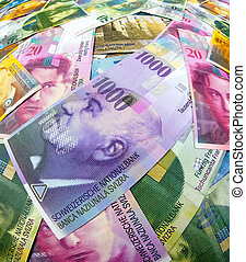 Swiss franc banknotes - Many Swiss franc banknotes of...