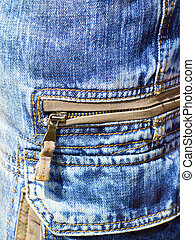 close-up of denim trousers with patch pockets with zip