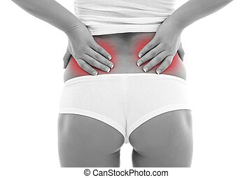 Back pain - Young woman holding her back, having pain