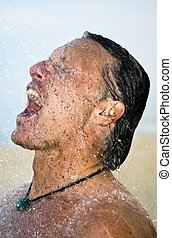 man washing under the shower