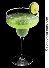 Green Margarita in front of a black background with fresh...