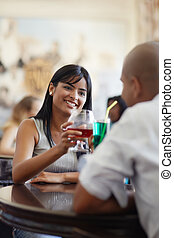 man and woman dating at restaurant - young adult hispanic...