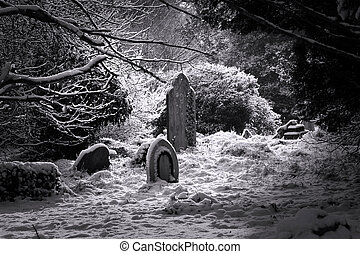 Gravestones - Old gravestones in the snow in black and white