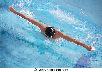swimmer performing butterfly stroke