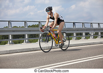 biker pedaling on race bike