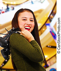 Smiling Teenager in a Shopping Center