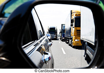 Truck traffic jam on highway - A traffic jam of cars and...
