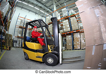 loading in storehouse - Worker in red uniform - Forklift...