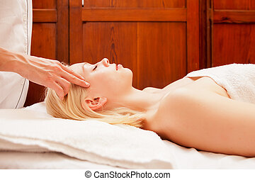 Spa Massage - A beautiful blonde woman receiving a head and...
