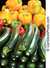 Cougettes and peppers - A display of courgettes and mixed...