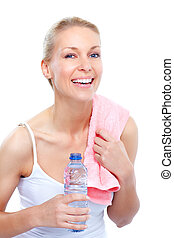 Fitness and gym. - Smiling young woman with water. Isolated...