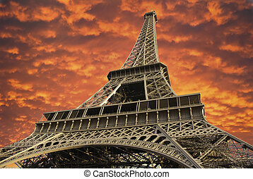 Eiffel Tower at Sunset in Paris, France - Bottom-Up view of...