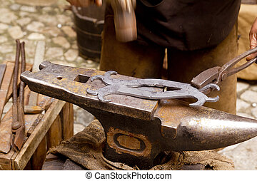 blacksmith forged iron smith anvil hammerman traditional...