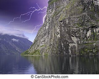 Clouds and Storm in Geiranger Fjord, Norway - Clouds and...