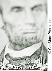 Close up of President Lincoln on five dollar bill - Money,...