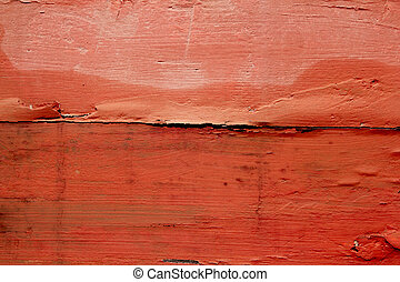 aged weathered wood painted in red orange color background...