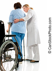 Care - nurse helps a senior woman on crutches