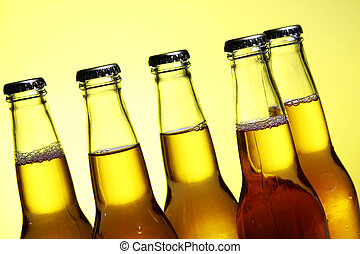 Bottles of cold and fresh beer with ice