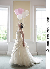 Bride and ballons - pretty bride in her wedding dress...