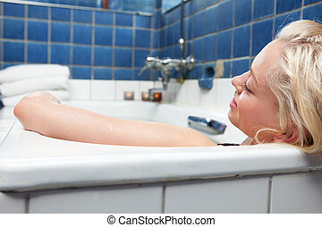 Woman in Relaxing Bath - An attractive blonde woman relaxing...