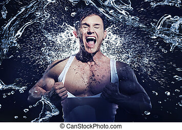 Stunning muscular man having shower
