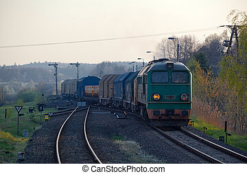Freight train hauled by the diesel locomotive starting from...