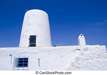Ancient white salt windmill mill in Formentera Balearic...