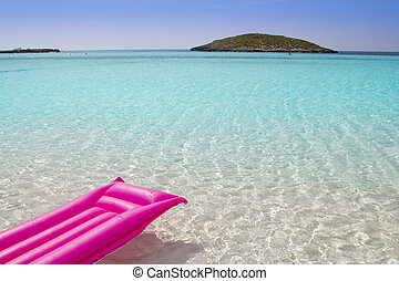 beach floating lounge pink tropical sea Formentera Balearic...