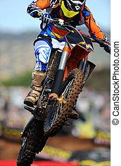 Dirt Bike - A dirt bike rider gets air during a stunt.