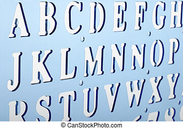 Backlit plastic alphabet stencil - Close up of backlit...