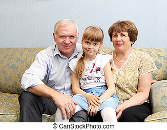 grandparents and granddaughter - grandparents with their...