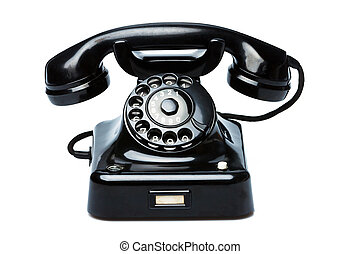 Antique, old retro phone. - An old, old landline telephone....