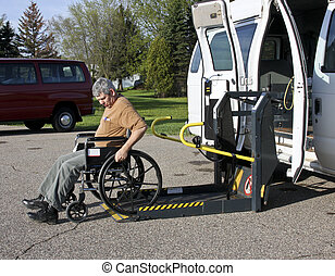 handicapped wheelchair lift - handicapped man in a...