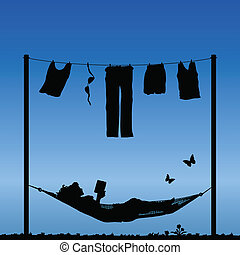 finishing the washing - Woman reading in a hammock after...