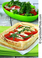 tart of puff pastry with peppers and goat cheese vegetable...