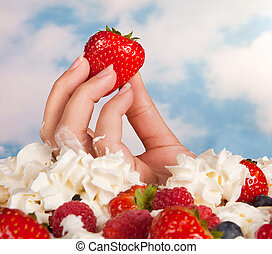 Better food than cream - Female hand on a diet holding a...