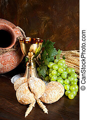 Jug of wine and communion bread - Grapes and holy bread next...