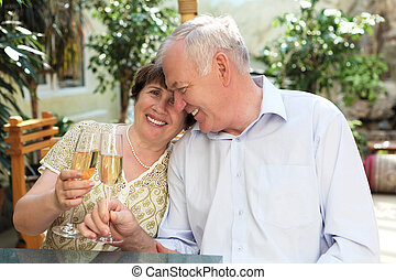 senior couple drinking champagne and celebrating together