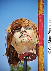 fake severed head - a fake severed head hanging on a spear...