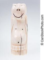 walrus bone Eskimo idol - Peliken on grey background