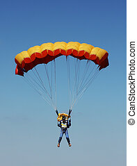 parachutist against the blue sky