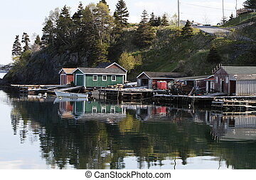 Dido, Newfoundland - A scenic view of the fish huts with...