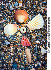 Cross shaped Shell Flower - Flower of colorful sea shells in...