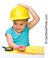 Cute little girl draw with marker wearing hard hat